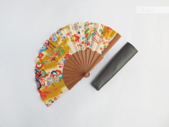 yellow hand fan
